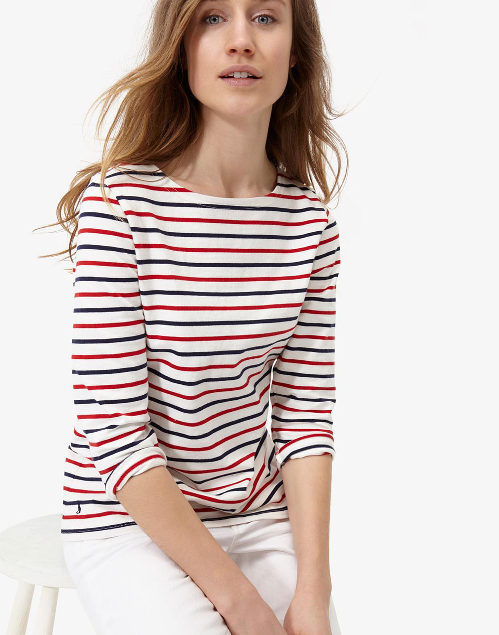 Cut from breezy double-knit cheesecloth, this fresh teen top can be worn on or off the shoulder for a cool and versatile style. The stripe print adds a fun nautical touch, while the ruffle shoulder detail and front buttons are both pretty and practical. Made from cotton, this .